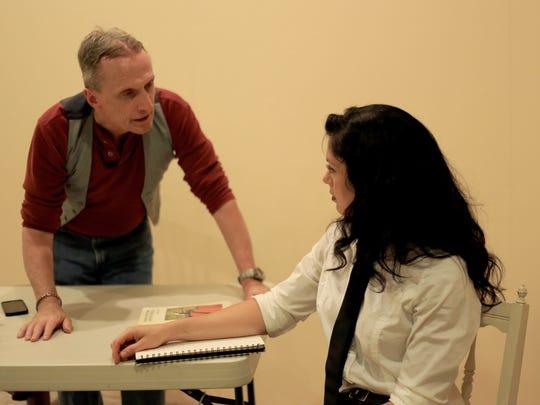 Richard Hill plays a professor and Christa Gross plays