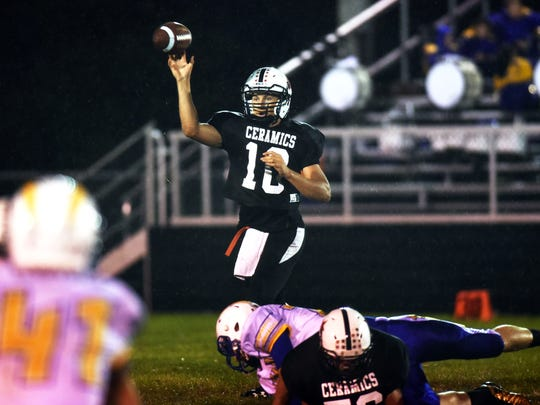 Crooksville's Landon Hinkle passes the ball against Philo.