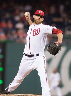 Relief pitcher Ryan Mattheus (52) pitches during the ninth inning against the Miami Marlins in game two of a baseball doubleheader at Nationals Park.
