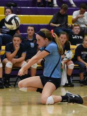Adena's Carly Carroll returns a serve during Adena's game against Unioto Tuesday at Unioto High School.