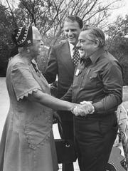 """Billy Graham, center, stands next to gospel singer Ethel Waters and Grady Wilson at """"Grady Wilson Day"""" in 1974 at a ranch near Blackwell. Graham and Waters were surprise guests for the event."""
