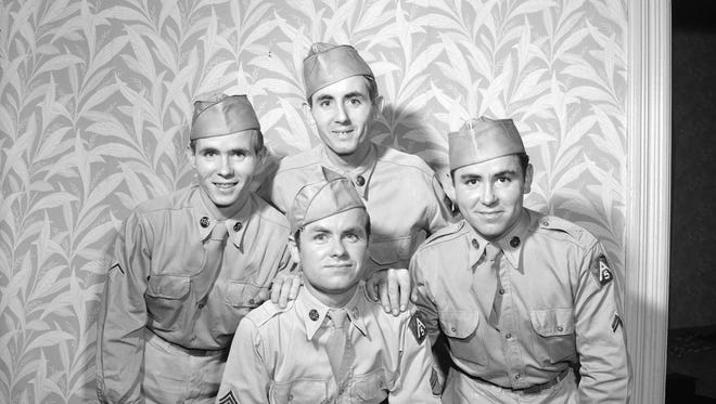 Edward Sleeth (center front), surrounded by his brothers, from left: Robert, Harry, and Thomas, ca. 1950