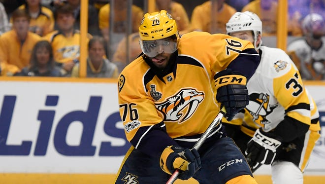 With tongue out, Predators defenseman P.K. Subban (76) moves the puck during the first period of Game 4 of the Stanley Cup Final on June 5, 2017.