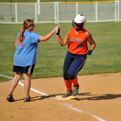 Millville's Rian Eigenmann (7) and Kaila Smith (99) react to their playoff quarterfinal loss to Cherrokee, at Millville High School, Wednesday, May 25, 2016.