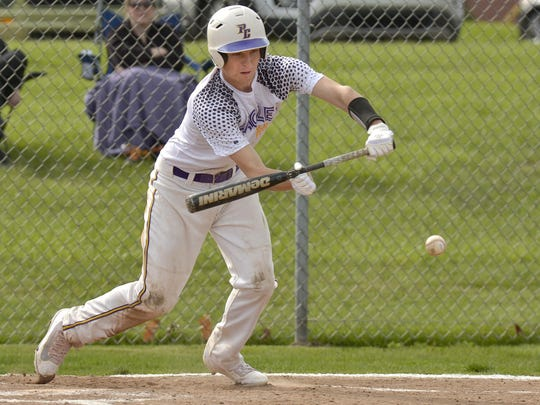 PCA's Austin Andres (No. 8) bunts for a base hit and a RBI during Tuesday's 14-4 win over Inter-City Baptist.