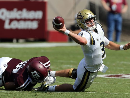 UCLA quarterback Josh Rosen (3) tries to throw the ball out of bounds as he is sacked by Texas A&M defensive lineman Kingsley Keke (88) during the second quarter of an NCAA college football game Saturday, Sept. 3, 2016, in College Station, Texas.