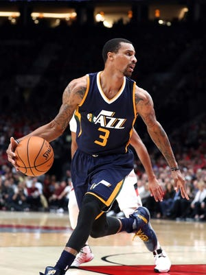 Oct 25, 2016; Portland, OR, USA; Utah Jazz guard George Hill (3) looks to pass the ball against the Portland Trail Blazers in the first half at Moda Center at the Rose Quarter. Mandatory Credit: Jaime Valdez-USA TODAY Sports