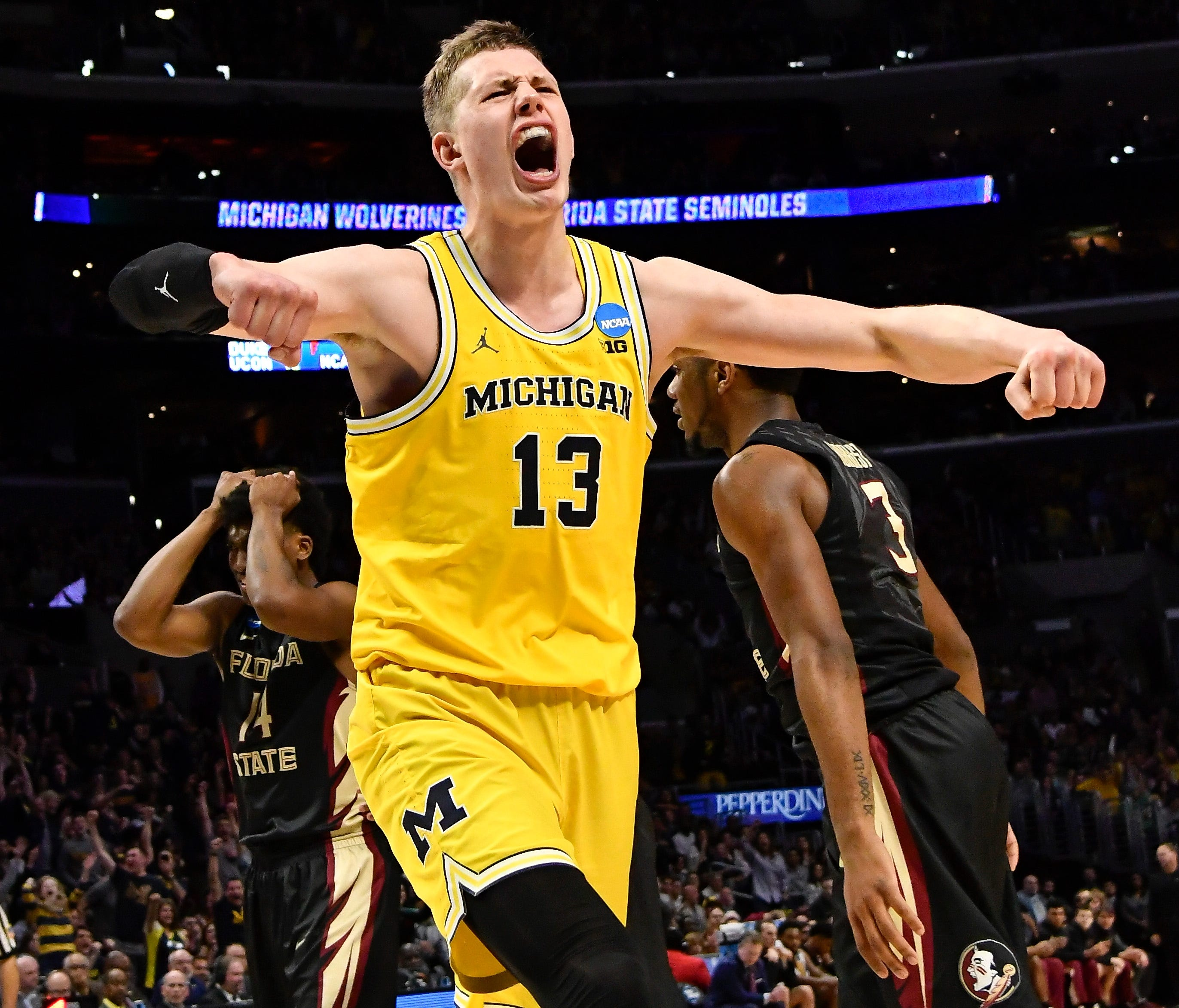 Michigan forward Moritz Wagner celebrates after scoring against Florida State in the championship game of the West regional of the 2018 NCAA tournament.