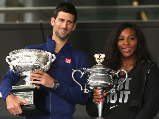 Defending champions Serena Williams of the US and Serbia's Novak Djokovic pose for a photo with their trophies as they arrive for the official draw at the Australian Open tennis championships in Melbourne, Australia, Friday, Jan. 15, 2016. (AP Photo/Mark Baker)