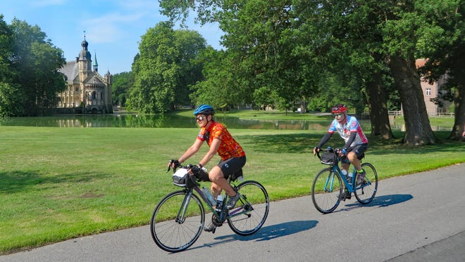 Ethan Brook and Barbara Augenblick riding by the Schloss Varlar castle in Germany.