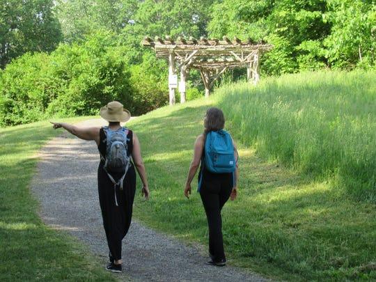 Hikers walk along Poet's Walk.
