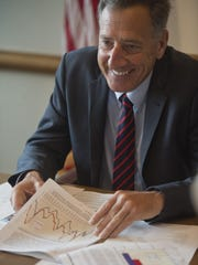 Gov. Peter Shumlin listens to an economic report during a budget meeting at his office in Montpelier Monday morning, July 27, 2015. According to the report, Vermont continues to improve economically, but at a slow pace.