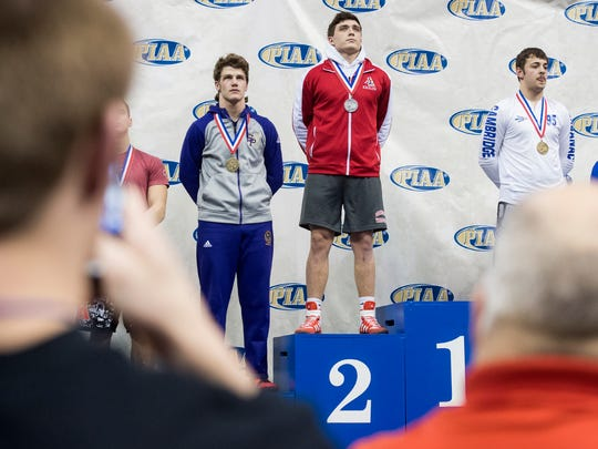 Bermudian Springs' Chase Dull stands on the podium after earning second place at 195 pounds at Hershey's Giant Center for the PIAA 2A Championships, Saturday, March 10, 2018.