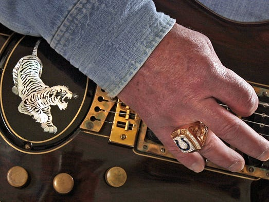 """Jim Irsay plays the Jerry Garcia """"Tiger"""" guitar at the Indiana State Museum in December 2011. The Colts CEO owns 175 historic guitars."""