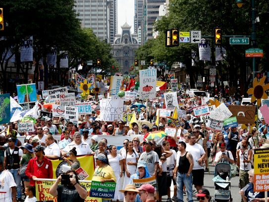 Protesters march during a demonstration in downtown