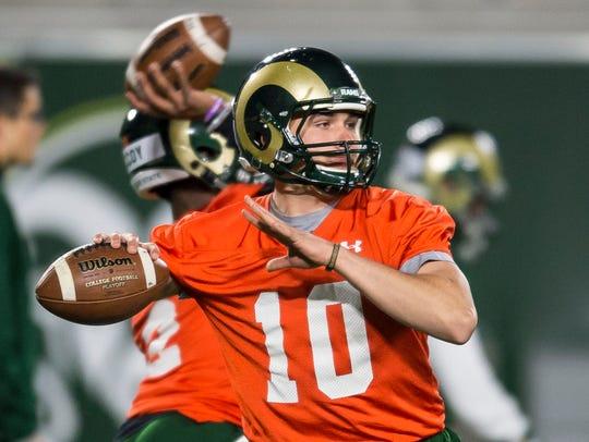 CSU junior quarterback J.C. Robles (10) participates