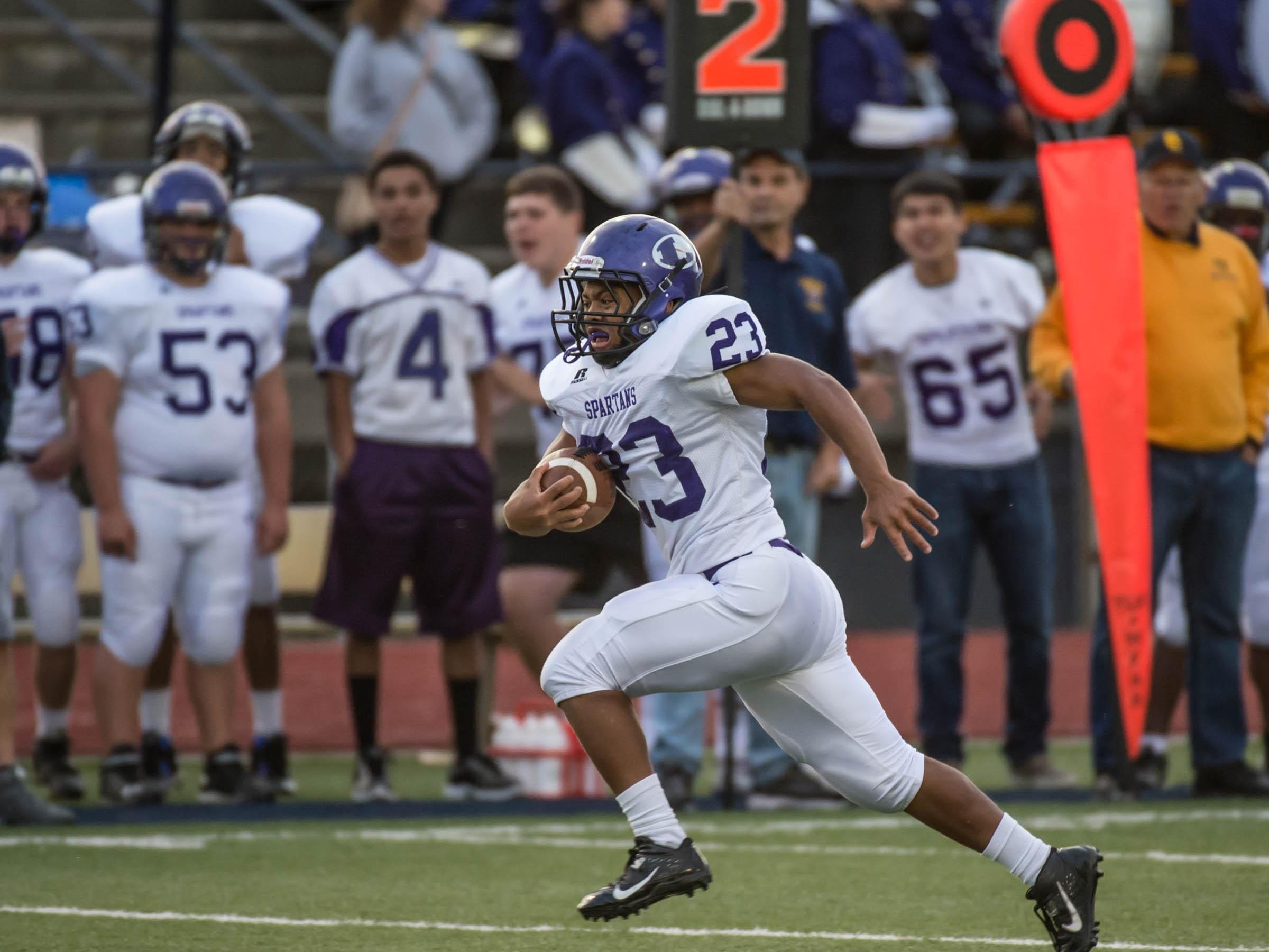 Lakeview's CJ Foster runs for big yardage during first half action against Battle Creek Central on Friday evening.