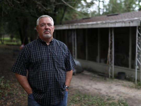 Glenn Burns stands outside the home in the Moon Landing neighborhood on the Northwest side of Tallahassee where he works with felons on reacclimating them to society. As few such centers allow for sex offenders, Burns says that most of his clients carry sex offense felonies, a fact that has neighbors concerned over the new tenants.