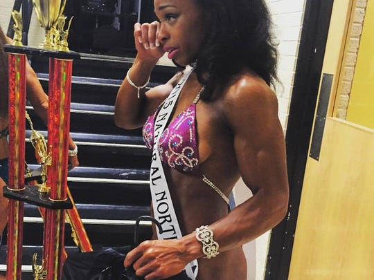 Rachel Shoemake wipes away a tear as it hits her that she was overall figure champion in the Natural Northern USA Championships.