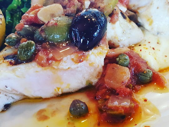 Grilled swordfish is served with puttanesca sauce and  polenta at The Bonney Read.