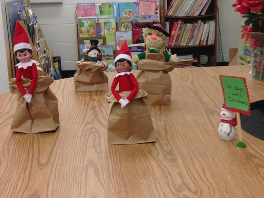 Elsa the elf and her friends have a sack race.