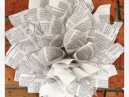 Meg Karetny suggested using paper – in the Courier-Post's case, old newspaper – to make a dahlia wreath for decoration.