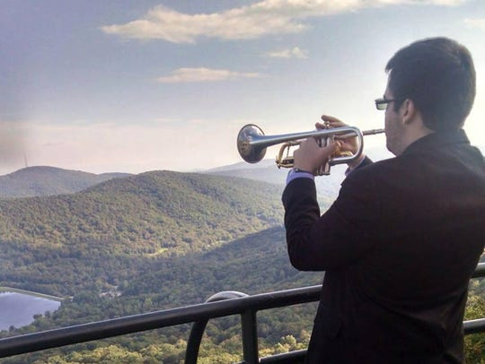 David Marvel plays the trumpet overlooking the Appalachian