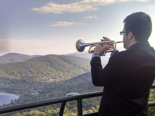 David Marvel plays the trumpet overlooking the Appalachian Mountains in Boone, N.C.