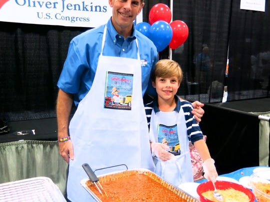 Shreveort City Councilman Oliver Jenkins and son Arthur servie chili dips and chips at Gentleman's Cooking Classic.