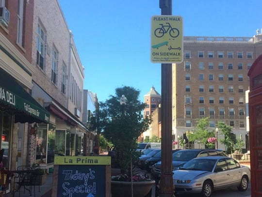 Sign in downtown Wausau asking people to walk their bikes on the sidewalk.