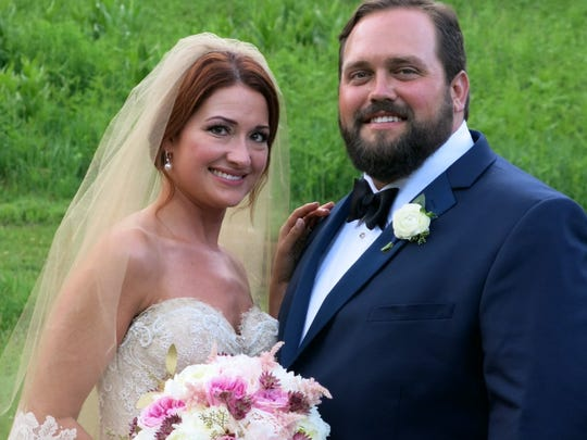 Bride Kelly Hackworth and groom Matthew Madden at their