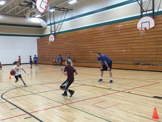 Paul Jesperson looks on during an offensive drill at his basketball camp last week in Menomonie.