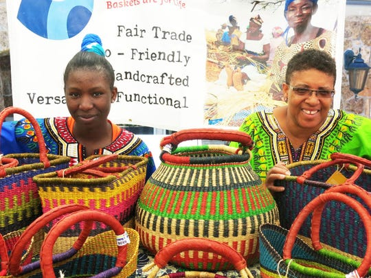 Colombe Ngoma and Simbala with Ti-a baskets from Ghanaat Vail Farmers' & Art Market.