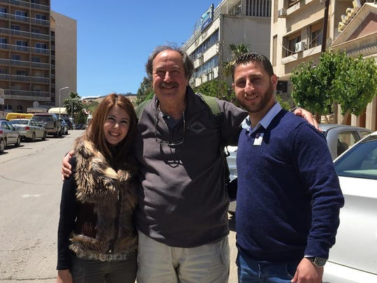 John Mesler (center) with two friends in Damascus.