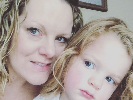 Natasha Bowen with her daughter Lily, 3, who is being treated for a late-stage cancer.