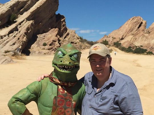 "Mike Scott (as the Gorn) and suit creator Tony Hardy pose at the ""Star Trek"" location where the Gorn made his debut in a 2015 pilgrimage to Vasquez Rocks, California."