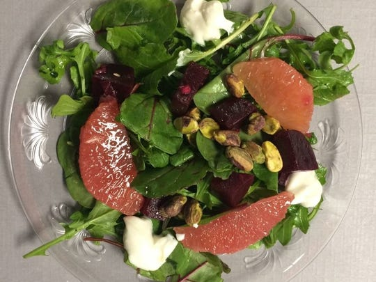Tinker Street's arugula and frisee salad with roasted
