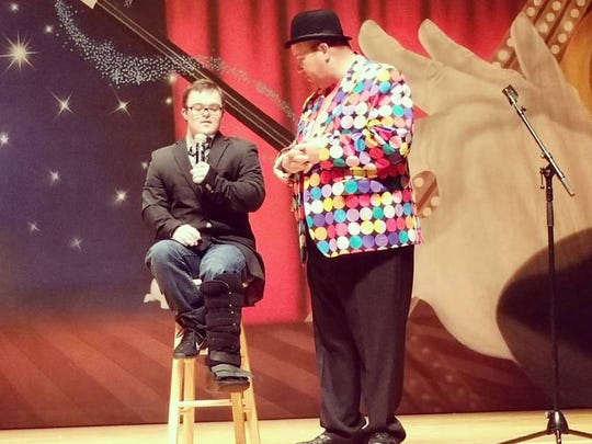 Self-advocate Collin Clarke and Emcee Tom Vorjohan at last year's Magic for SMILEs.