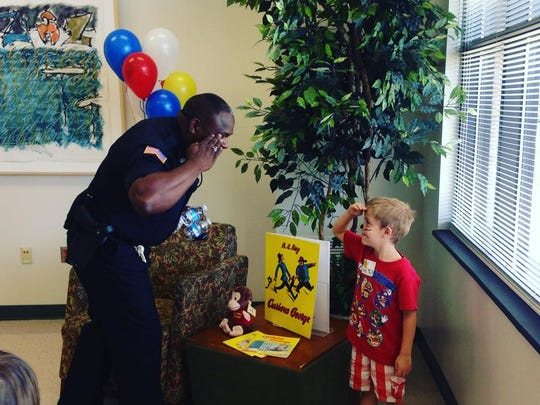 Richmond Police Department officer Aaron Stevens salutes