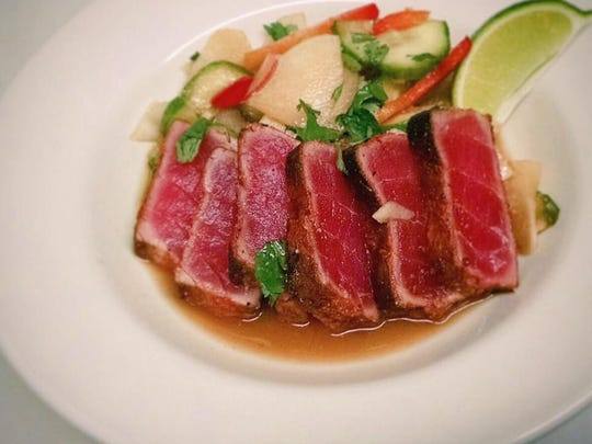 Star Diner's small plates menu includes seared ahi tuna with daikon cucumber salad, soy vinaigrette and sesame seeds.