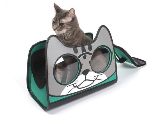 A backpack cat carrier, the Catysmile from primetimepetz.com.
