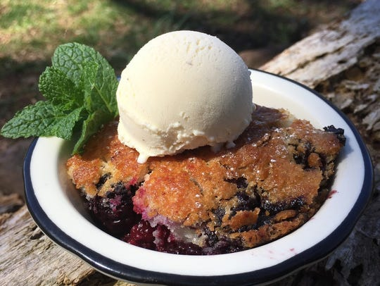Blackberry Cobbler topped with ice cream is a quintessentially