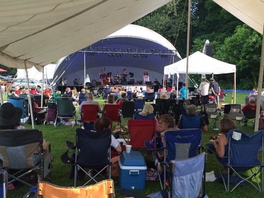 The Rock House Music Festival is held rain or shine, with a large tent set up on the festival grounds.