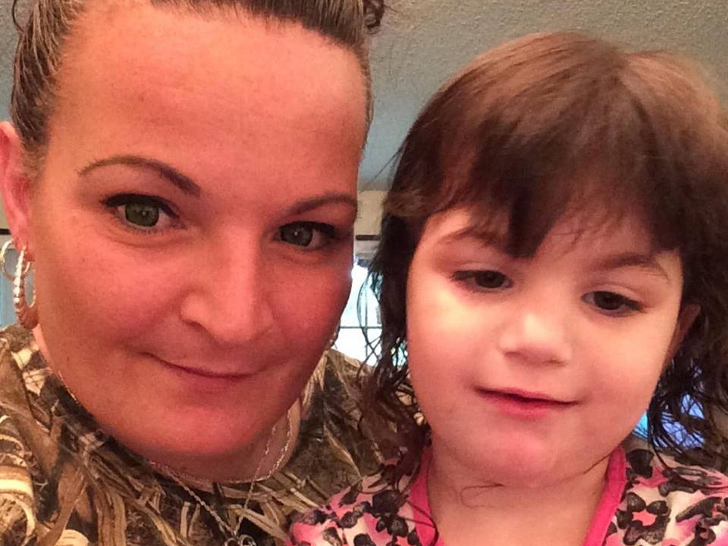 Lisa with her daughter, Antonia, who is fighting brain
