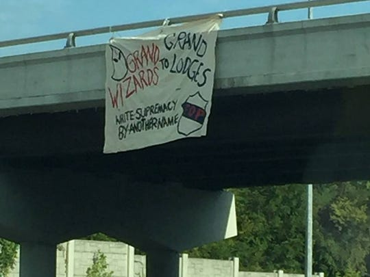 Members of SURJ and other groups hung banners from interstate overpasses around Nashville on Sunday.