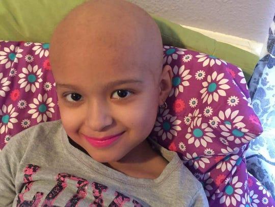 Mia De Leon, 7, has leukemia. Her father, Porfirio