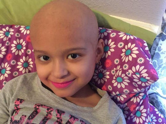 Mia De Leon, 7, has leukemia. Her father, Porfirio