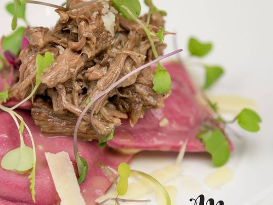 Beet ravioli with mushrooms, braised short ribs, spinach,