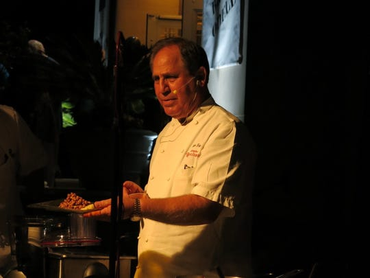 Chef John Folse presents a cooking demonstration at