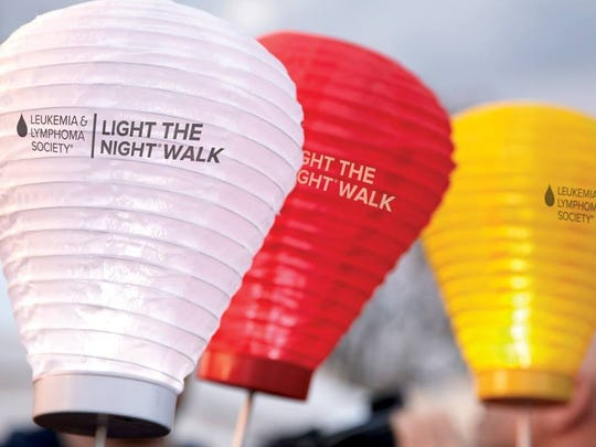 Walkers at Light the Night carry illuminated lanterns -- red for supporters, white for survivors, and gold in memory of those who died of blood cancers.